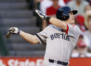 FILE PHOTO: Boston Red Sox's Brock Holt hits a sacrifice fly to score Daniel Nava against the Los Angeles Angels during the second inning of their MLB American League baseball game in Anaheim, California July 6, 2013. REUTERS/Danny Moloshok