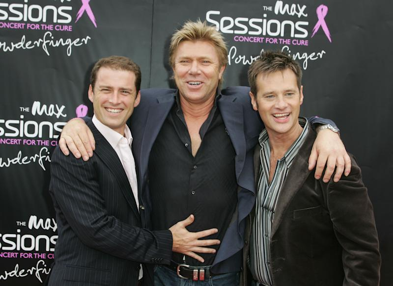 A photo of Today show hosts Karl Stefanovic, Richard Wilkins and Richard Reid at the Powderfinger Concert for the Cure on October 31, 2007 in Sydney, Australia.
