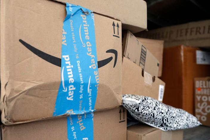 FILE - In this July 17, 2018, file photo Amazon Prime packages sit in a delivery truck before being unloaded in Miami. It's just a week into the holiday shopping season, and Amazon is already having trouble getting packages to shoppers' doorsteps on time. The company said the delays are due to bad weather in parts of the country and the large amount of orders it received during the Thanksgiving weekend, when it offered steep discounts. (AP Photo/Lynne Sladky, File)