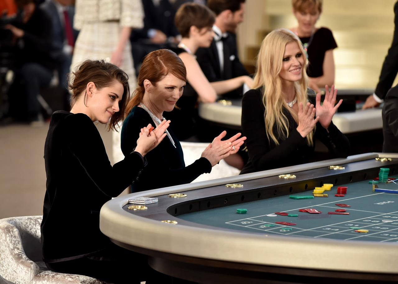 "<p>Now this is one fashion show we wish we could've been at. The likes of Julianne Moore, Kristen Stewart and Lara Stone sat and ""gambled"" in a specially constructed casino as models walked around them.<i> [Photo: Getty]</i></p>"
