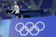 Alexander Zverev, of Germany, returns a shot to Karen Khachanov, of the Russian Olympic Committee, during the men's single gold medal match of the tennis competition at the 2020 Summer Olympics, Sunday, Aug. 1, 2021, in Tokyo, Japan. (AP Photo/Patrick Semansky)