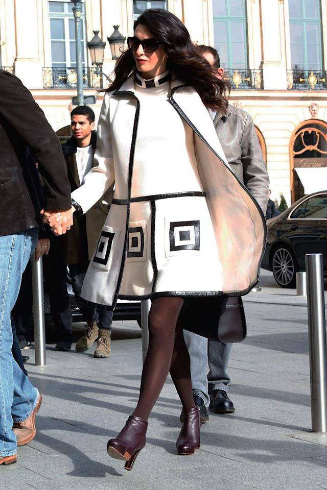 <p>Amal leaving L'Hôtel in Paris with George in a 60s jacket and dress.</p>