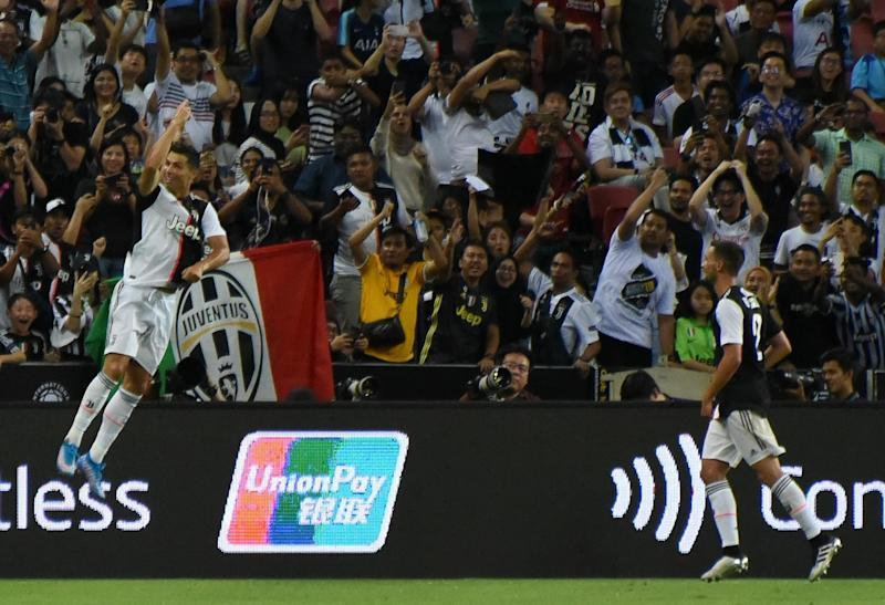 Juventus star Cristiano Ronaldo (left) celebrates his goal against Tottenham in their International Champions Cup match at the National Stadium. (PHOTO: Zainal Yahya/Yahoo News Singapore)