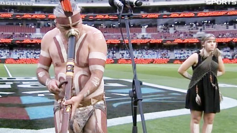 Karl Telfer, pictured here playing the didgeridoo at the Adelaide Oval.