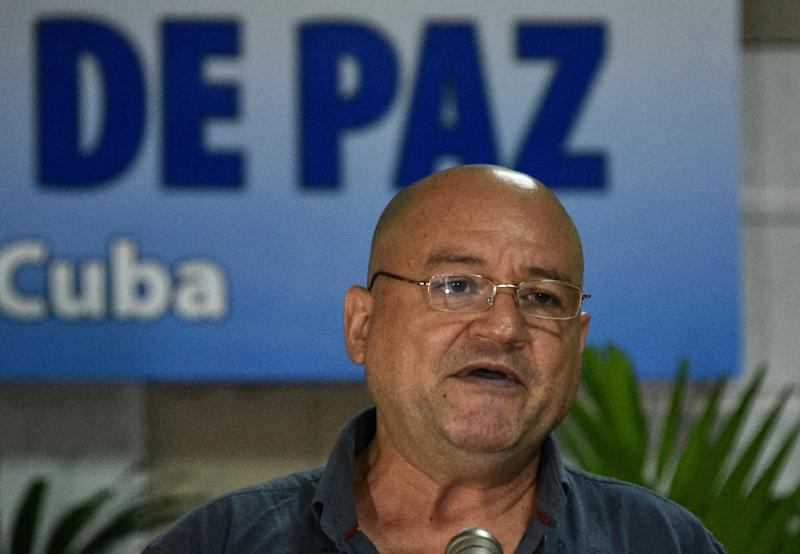 Carlos Antonio Lozada, member of the FARC-EP leftist guerrilla delegation, reads a statement at the start of peace talks with the Colombian government on November 3, 2015 in Havana