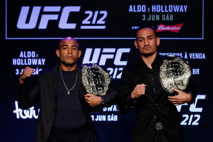 Max Holloway (R) hasn't lost a UFC fight in nearly four years, but he's facing an all-time legend in Jose Aldo. (Getty)