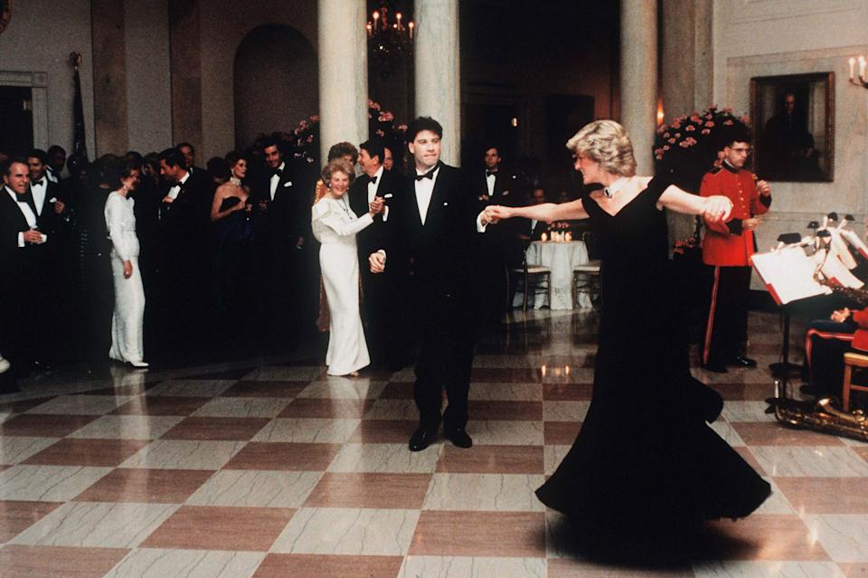 WASHINGTON, UNITED STATES - NOVEMBER 09:  Diana,  Princess Of Wales, watched by President Ronald Reagan and wife Nancy,  dances with John Travolta at the White House, USA  on November 9, 1985.  Diana is wearing a midnight blue velvet dress by designer Victor Edelstein. (Photo by Anwar Hussein/WireImage)