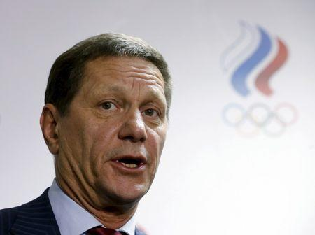 Russian Olympic Committee head Alexander Zhukov addresses journalists after an extraordinary meeting on issues, connected with Russian athletics team and federation, and held by the executive committee of the Russian Olympic Committee in Moscow