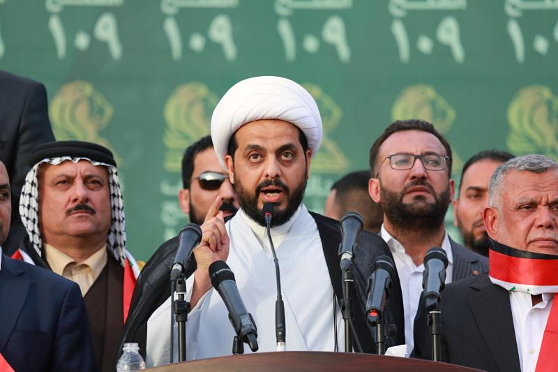 In this Monday, May 7, 2018 file photo, Qais al-Khazali, center, the leader of the militant Shiite group Asaib Ahl al-Haq, or League of the Righteous, speaks to his followers during a campaign rally in Baghdad, Iraq. The unexpected alliance between Iraq's mercurial Shiite cleric Muqtada al-Sadr and an Iran-backed coalition of powerful Shiite militias, who fought Islamic State group, will boost Tehran interests in Iraq and give it more leverage over the process of forming the next government. (AP Photo/Hadi Mizban, File)
