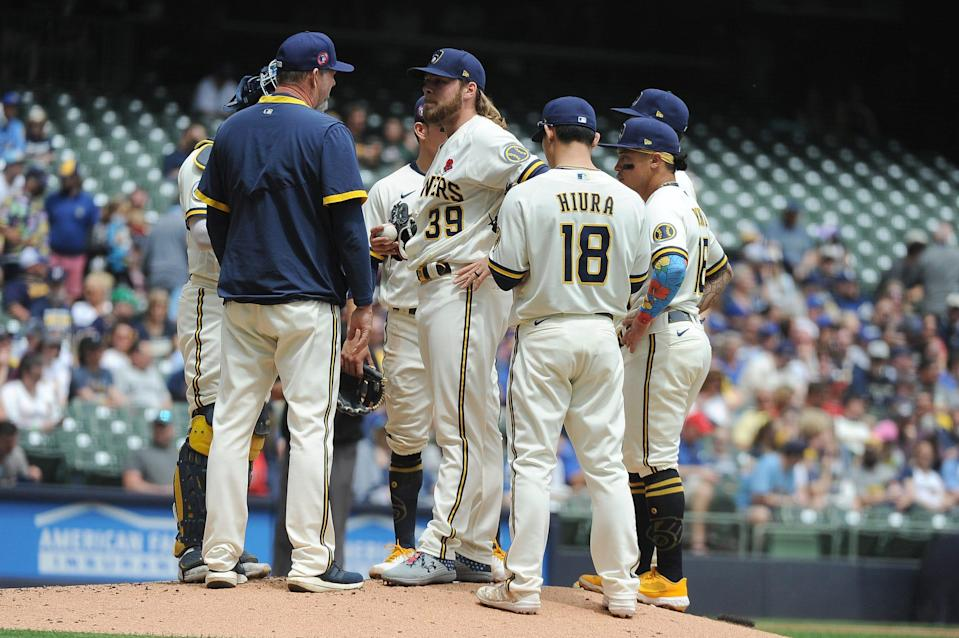 Milwaukee Brewers pitching coach Chris Hook (48) visits Milwaukee Brewers starting pitcher Corbin Burnes (39) in the second inning May 31, 2021 against the Detroit Tigers at American Family Field in Milwaukee.