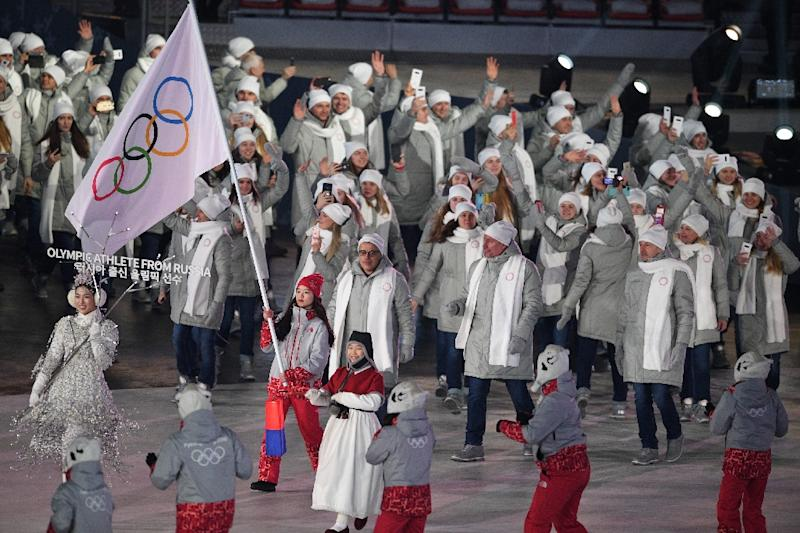 "Russian athletes marched behind an Olympic flag and the standard ""Olympic Athlete from Russia"" at the opening ceremony and will have to do the same at the closing ceremony after the IOC maintained a ban on Russia"
