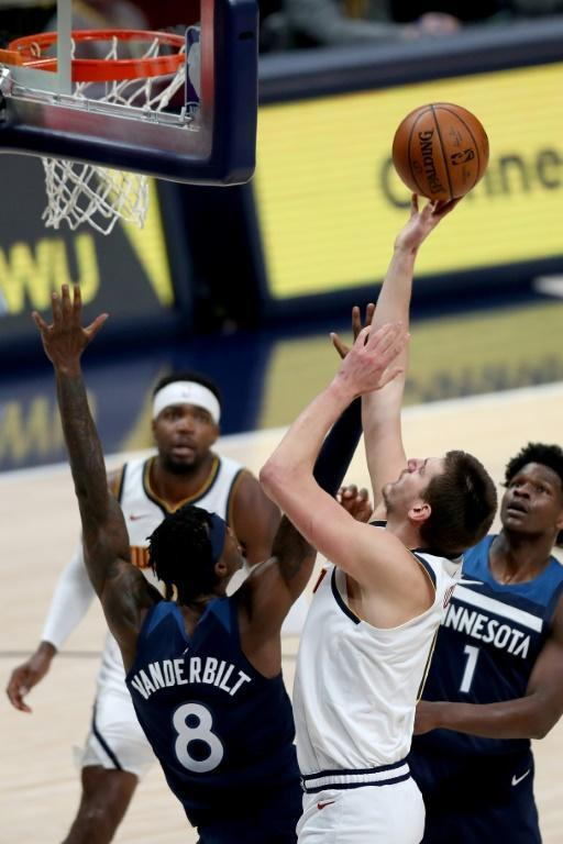 Denver's Nikola Jokic puts up a shot in the Nuggets' 123-116 NBA victory over the Minnesota Timberwolves