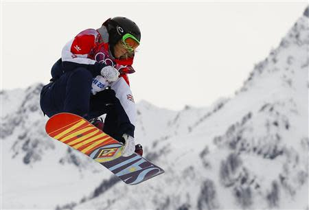 Britain's Jenny Jones performs a jump during the women's snowboard slopestyle finals event at the 2014 Sochi Winter Olympics in Rosa Khutor, February 9, 2014. REUTERS/Lucas Jackson