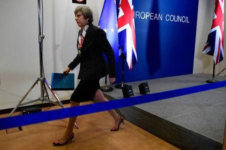 Britain's Prime Minister Theresa May leaves a news conference during the EU Summit in Brussels