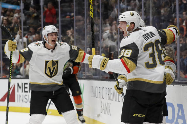 Vegas Golden Knights center Patrick Brown, right, celebrates with defenseman Nick Holden, left, after scoring during the first period of an NHL hockey game against the Anaheim Ducks in Anaheim, Calif., Sunday, Feb. 23, 2020. (AP Photo/Chris Carlson)