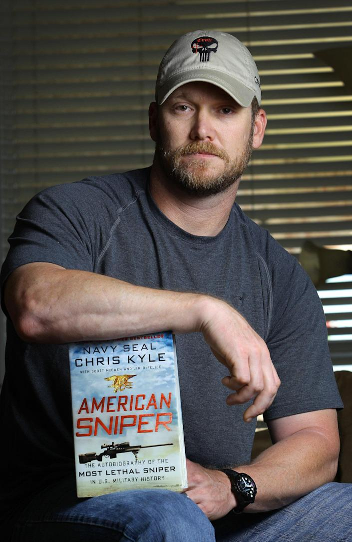 """In this April 6, 2012, photo, former Navy SEAL and author of the book """"American Sniper"""" poses in Midlothian, Texas. A Texas sheriff has told local newspapers that Kyle has been fatally shot along with another man on a gun range, Saturday, Feb. 2, 2013. (AP Photo/The Fort Worth Star-Telegram, Paul Moseley)"""