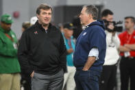 FLUE - In this March 20, 2019, file photo, Georgia coach Kirby Smart, left, and New England Patriot coach Bill Belichick talk during Georgia Pro Day in Athens, Ga. Some college coaches are making a more concerted effort to sell the players who didn't get a chance to work out in front of NFL scouts. (AP Photo/John Amis, File)
