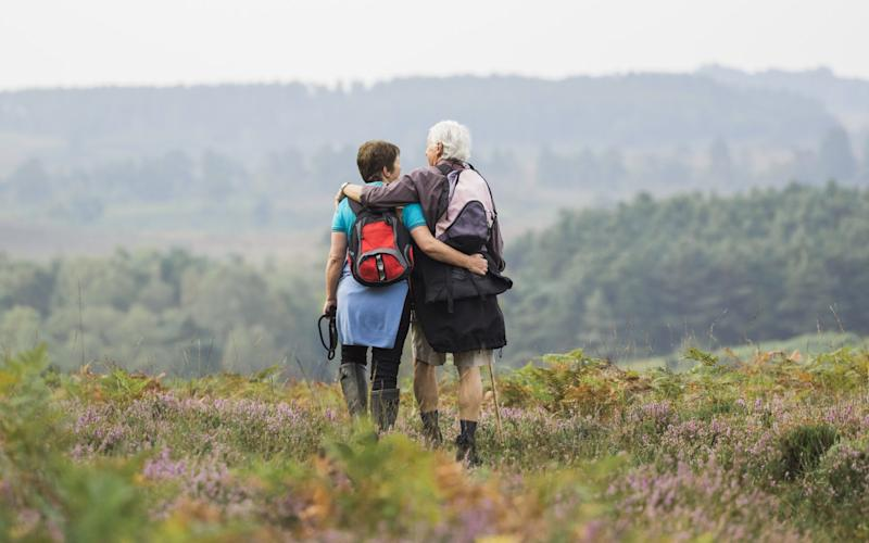 Walking downhill involves more gravity, helping to preserve bones post-menopause - Mint Images RF