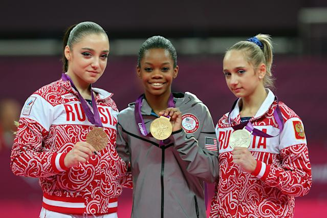LONDON, ENGLAND - AUGUST 02: Bronze medalist Aliya Mustafina of Russia, gold medalist Gabrielle Douglas of the United States and silver medalist Victoria Komova of Russia pose after the medal ceremony in the Artistic Gymnastics Women's Individual All-Around final on Day 6 of the London 2012 Olympic Games at North Greenwich Arena on August 2, 2012 in London, England. (Photo by Julian Finney/Getty Images)
