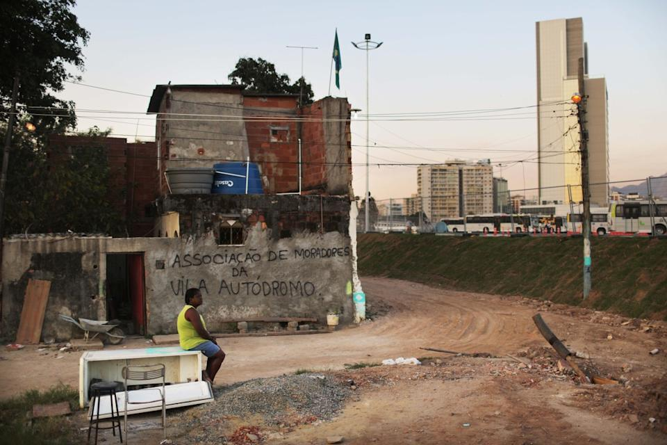 Sandra Regina sits by her old home in the former favela community next to Olympic Park. (Getty Images)