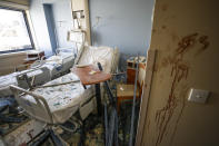 FILE - In this August 5, 2020 file photo, a hospital room is damaged from a massive explosion on Aug. 4, in Beirut, Lebanon. The health services and facilities in Lebanon were once considered among the region's best. But in a short time, they have been brought to near collapse, battered by Lebanon's financial meltdown and a surge in coronavirus cases, then smashed by the Beirut explosion. (AP Photo/Hassan Ammar, File)