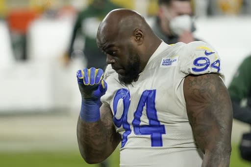 Los Angeles Rams defensive tackle A'Shawn Robinson walks off the field after an NFL divisional playoff football game against the Green Bay Packers Saturday, Jan. 16, 2021, in Green Bay, Wis. The Packers defeated the Rams 32-18 to advance to the NFC championship game. (AP Photo/Morry Gash)