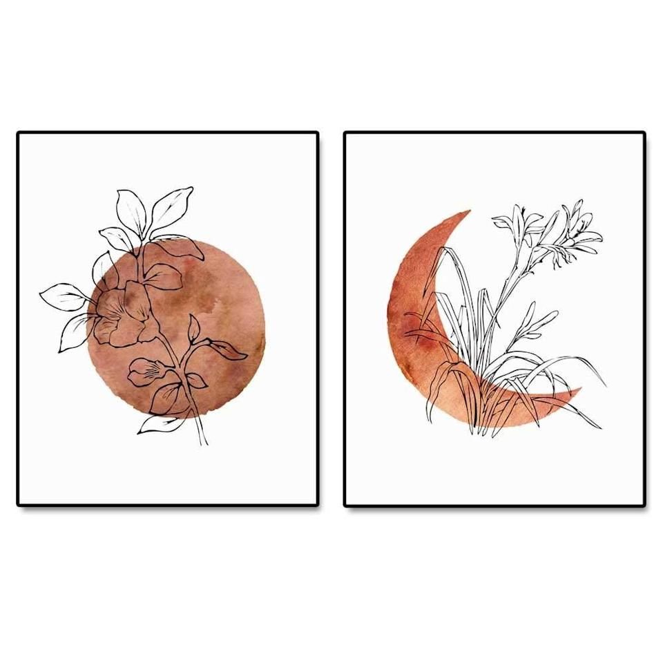 <p>Decorate your space with the neutral toned <span>ArtPrint Terracotta Sun and Moon Print</span> ($16).</p>