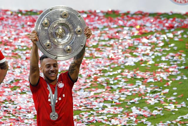Soccer Football - Bundesliga - Bayern Munich v VfB Stuttgart - Allianz Arena, Munich, Germany - May 12, 2018 Bayern Munich's Corentin Tolisso celebrates winning the Bundesliga with the trophy REUTERS/Michaela Rehle DFL RULES TO LIMIT THE ONLINE USAGE DURING MATCH TIME TO 15 PICTURES PER GAME. IMAGE SEQUENCES TO SIMULATE VIDEO IS NOT ALLOWED AT ANY TIME. FOR FURTHER QUERIES PLEASE CONTACT DFL DIRECTLY AT + 49 69 650050