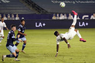Los Angeles Galaxy's Yony Gonzalez, right, takes a shot on goal with a scissor kick during the first half of an MLS soccer match against the Vancouver Whitecaps, Sunday, Oct. 18, 2020, in Carson, Calif. (AP Photo/Marcio Jose Sanchez)