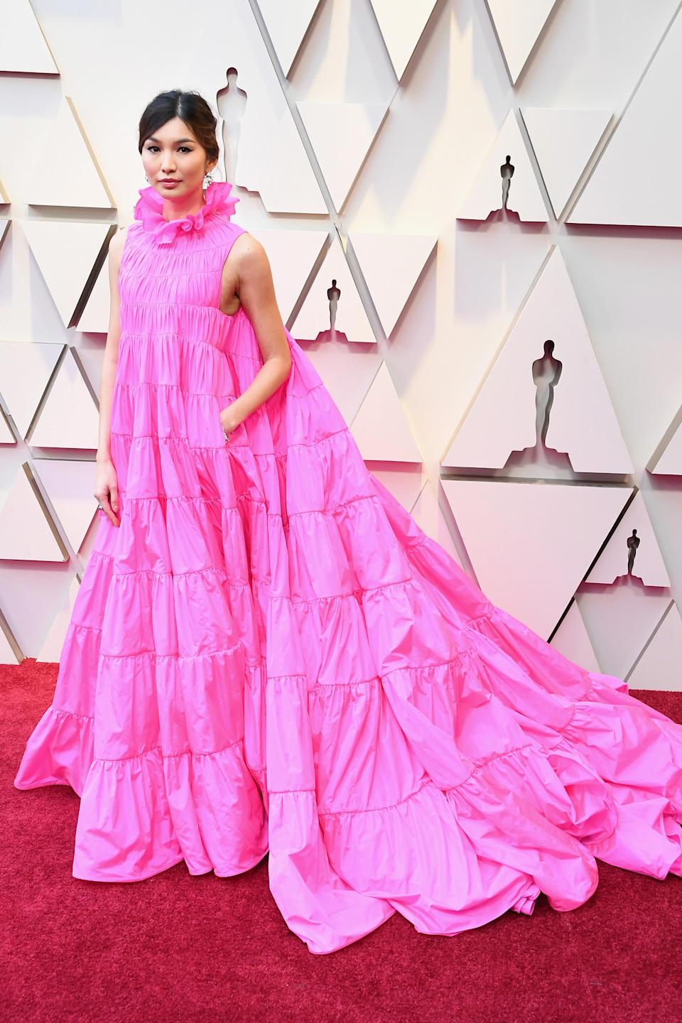 """<p>The """"Crazy Rich Asians"""" star looked fashion forward in a bright pink ruffled gown (with pockets) by Valentino. (Image via Getty Images) </p>"""