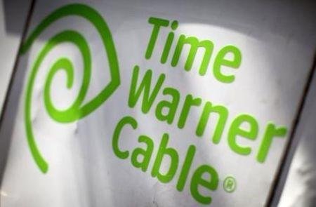 A Time Warner Cable sign and logo are seen on the back of a Time Warner Cable service truck in the Manhattan borough of New York City