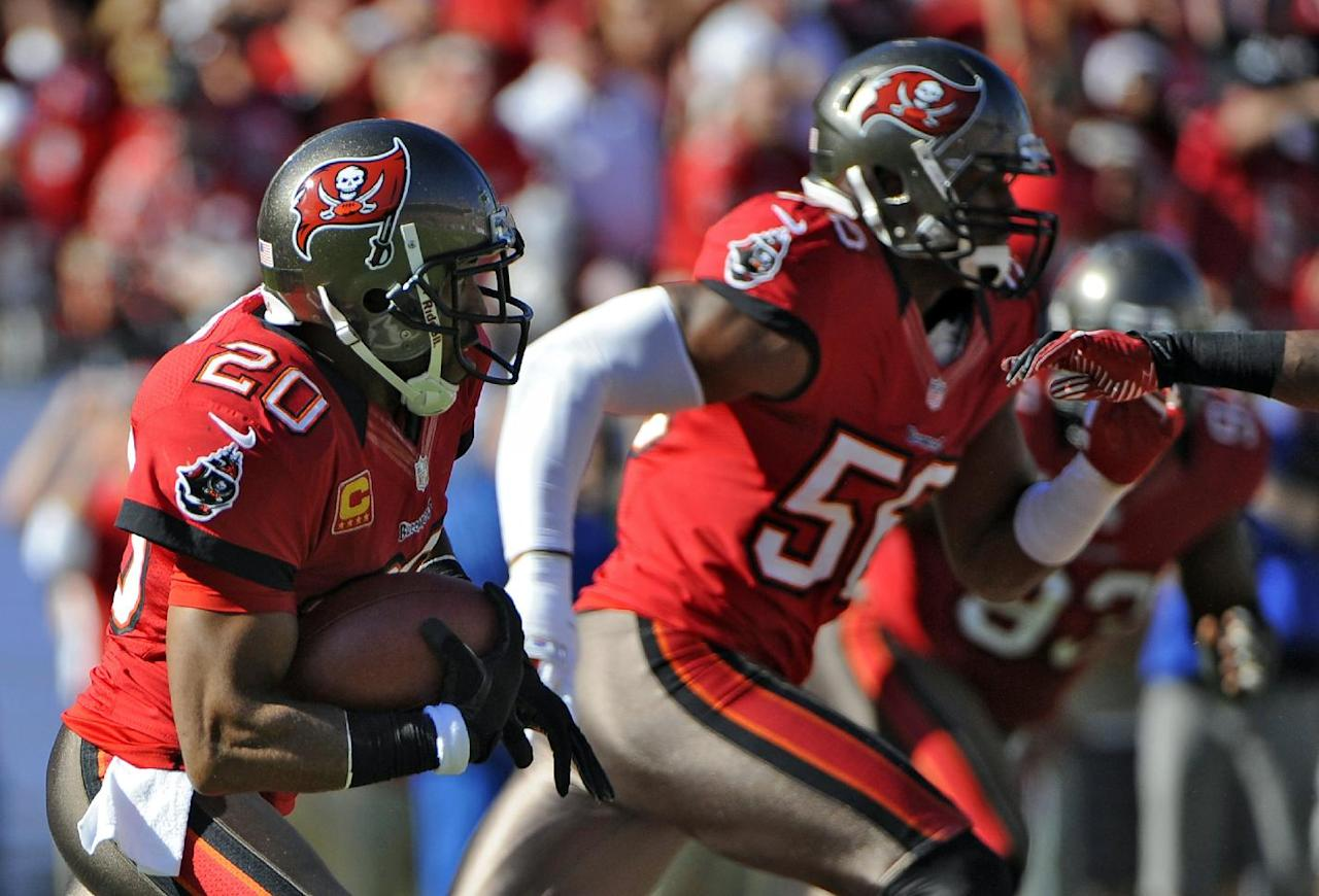 Tampa Bay Buccaneers free safety Ronde Barber (20) heads upfield with teammate linebacker Dekoda Watson (56) after intercepting a pass by Atlanta Falcons quarterback Matt Ryan during the second quarter of an NFL football game on Sunday, Nov. 25, 2012, in Tampa, Fla. (AP Photo/Brian Blanco)