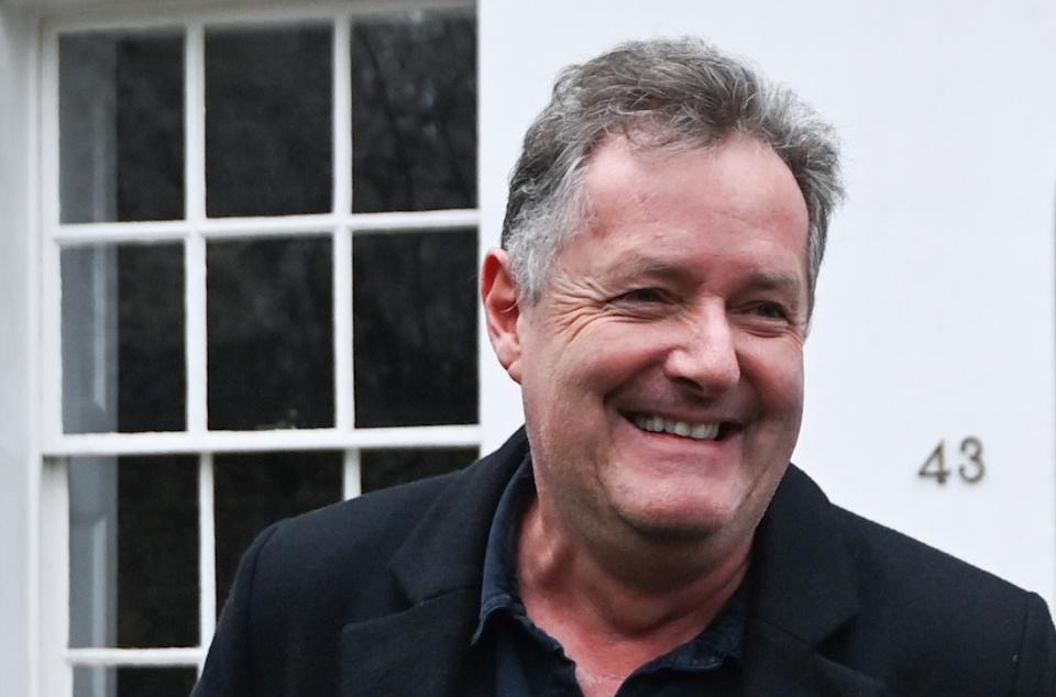 Journalist and television presenter Piers Morgan smiles as he steps out of his house, after he left his high-profile breakfast slot with the broadcaster ITV, following his long-running criticism of Prince Harry's wife Meghan, in London, Britain, March 10, 2021. REUTERS/Toby Melville
