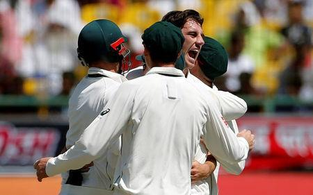 Cricket - India v Australia - Fourth Test cricket match - Himachal Pradesh Cricket Association Stadium, Dharamsala, India - 26/03/17 - Australia's Pat Cummins celebrates with his teammates after dismissing India's Lokesh Rahul. REUTERS/Adnan Abidi