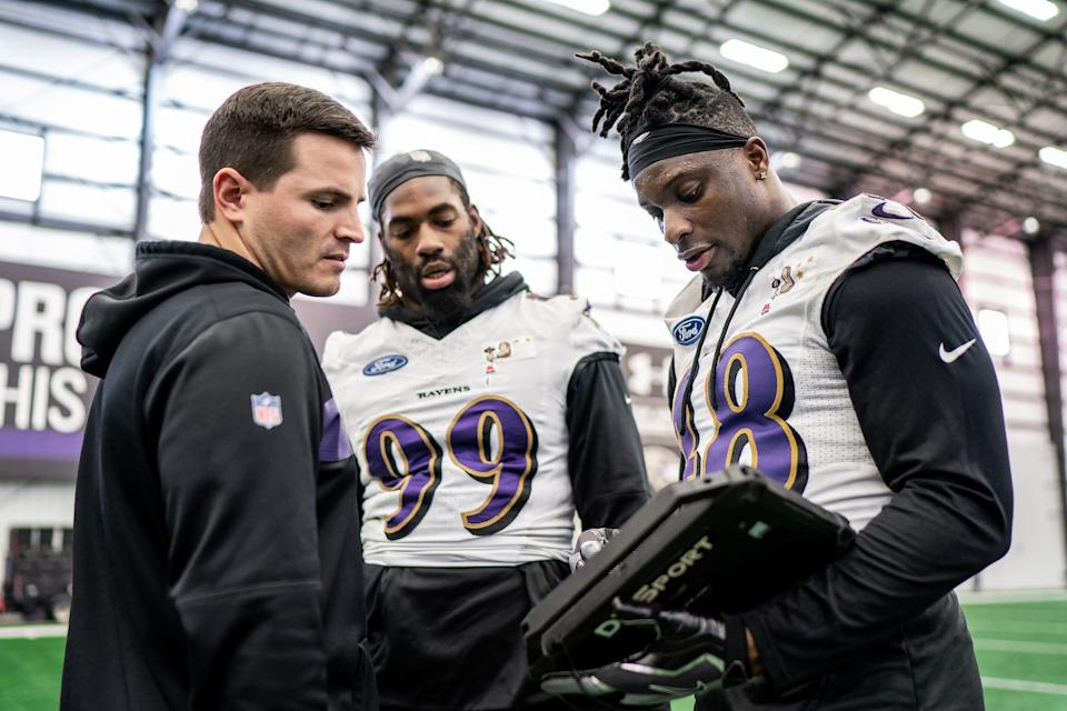 Baltimore Ravens linebackers coach Mike MacDonald with Patrick Onwuasor (48) and Matthew Judon (99) in 2019.