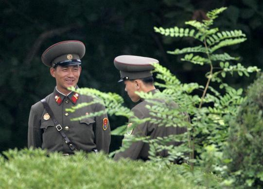 A North Korean soldier smiles as he talks with fellow soldier at the truce village of Panmunjom, in the demilitarized zone separating the two Koreas, in Paju, north of Seoul south of Pyongyang, September 11, 2008.