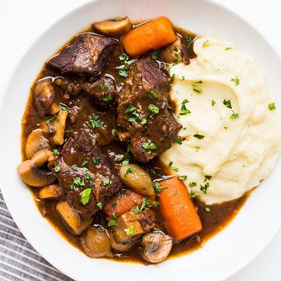 """<p>There's nothing bad about beef, butter, or wine, and the three are even better when mixed together in a stew like beef bourguignon. Although this classic dish from <a href=""""https://www.foodandwine.com/slideshows/burgundy-pairings"""" target=""""_blank"""">Burgundy</a> takes a while to cook, don't be put off. The techniques involved are easy to master. </p> <p> <a href=""""http://www.foodandwine.com/recipes/beef-bourguignon"""">Go to Recipe</a></p>"""