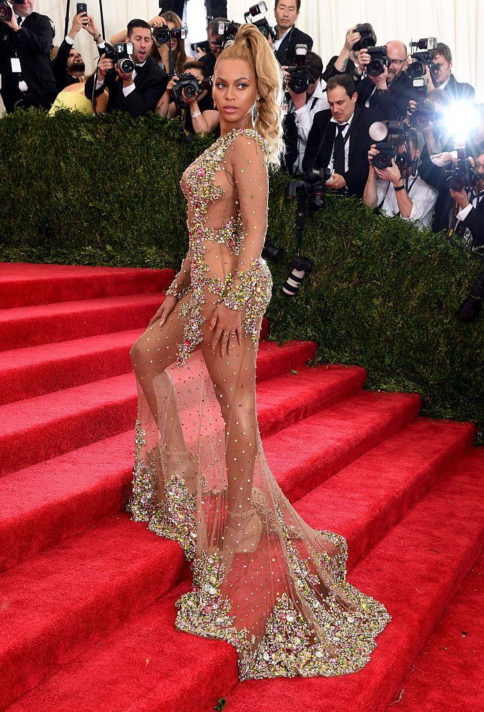 <p>Beyoncé might have arrived late to the 2015 Met Gala, but it was worth the wait. The singer bought back the naked dress, wearing an entirely sheer Givenchy gown with strategically placed jewels. It was a look that instantly went down in Met Gala history. </p>