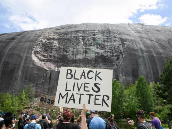 (Getty Images) A Black Lives Matter protest in front of the Stone Mountain Confederate Memorial