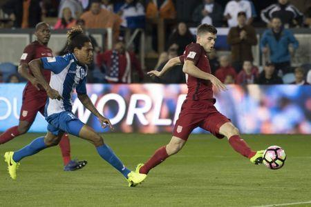 March 24, 2017; San Jose, CA, USA; United States midfielder Christian Pulisic (10) kicks the ball against Honduras defender Henry Figueroa (4) during the first half of the Men's World Cup Soccer Qualifier at Avaya Stadium. Mandatory Credit: Kyle Terada-USA TODAY Sports
