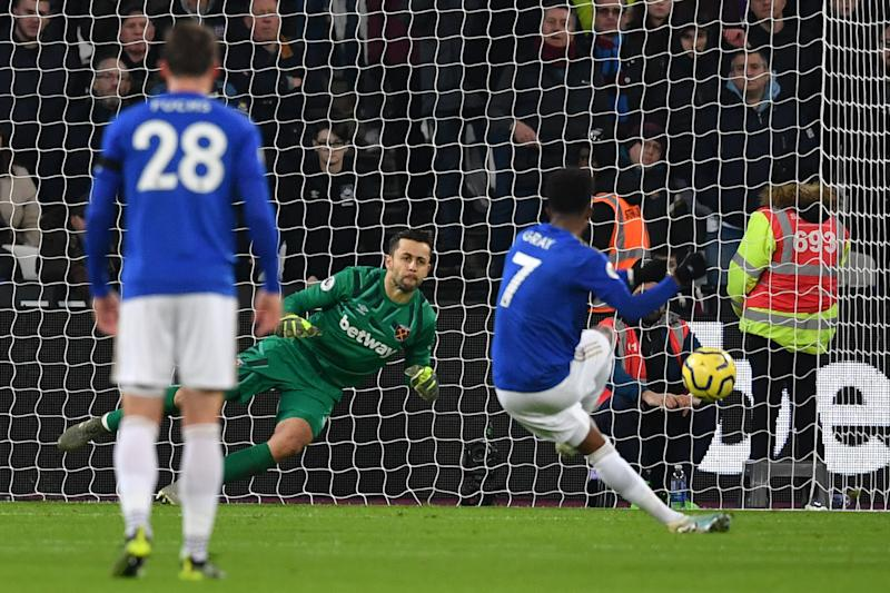West Ham United's Polish goalkeeper Lukasz Fabianski dives to save a penalty taken by Leicester City's English midfielder Demarai Gray (R) during the English Premier League football match between West Ham United and Leicester City at The London Stadium, in east London on December 28, 2019. (Photo by Ben STANSALL / AFP) / RESTRICTED TO EDITORIAL USE. No use with unauthorized audio, video, data, fixture lists, club/league logos or 'live' services. Online in-match use limited to 120 images. An additional 40 images may be used in extra time. No video emulation. Social media in-match use limited to 120 images. An additional 40 images may be used in extra time. No use in betting publications, games or single club/league/player publications. / (Photo by BEN STANSALL/AFP via Getty Images)