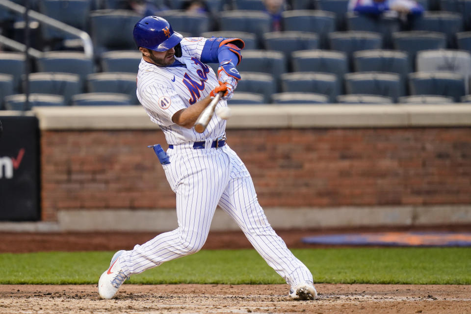 New York Mets' Pete Alonso hits an RBI single during the eighth inning against the Philadelphia Phillies in the first game of a baseball doubleheader Tuesday, April 13, 2021, in New York. The Mets won 4-3 in eight innings. (AP Photo/Frank Franklin II)