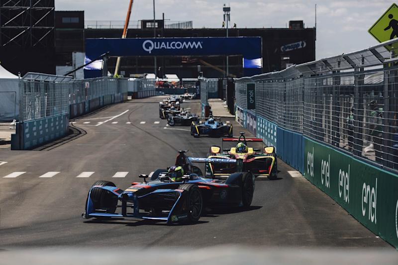 "(Bloomberg) -- If you want to know what your car might be like in 2030, and which brands—automotive or otherwise—may be the ones to make it, go watch a Formula E race.The single-seater racing series, now in its fifth season, is like Formula 1—with open-cockpit cars powered by electricity, rather than gas. The next E-Prix will take place on July 13 and 14 in Red Hook in Brooklyn, N.Y. It's the site of the final two races of the season and the only one this year set in U.S. shores.And it's a big deal. Audi, BWM, Mercedes-Benz, Mahindra, NIO, Nissan, Virgin, Jaguar, and Porsche are all multimillions-of-dollars-deep into developing their involvement; Nico Rosberg, Qualcomm, and Discovery are investors. They see the racing series as a critical testing ground for technologies on tap for the transportation devices of the future. And such brands as Hugo Boss, Bremont, and Tag Heuer, among others, are hosting parties, conferences, and drive events for press and VIPs throughout the week preceding the races; Harley Davidson is using it as an opportunity to unveil its first-ever electric motorcycle, Project Livewire, to selected media for first-ride reviews.Indeed, Formula E is a celebration of the future of electric autos. It provides stark relief between those companies that can make a viable electric motor and those that can't. Whereas F1 technologies are so proprietary and secretive that fans need they need a university degree to wade through the distinctions, Formula E teams use the same battery with the same amount of energy; the team that designs the most efficient motor is very likely to win. (That's with no small effort from one of the welterweight-fit race car drivers, of course.)The stakes are high, if still speculative. Today, battery-powered vehicles account for 1.2% of automotive sales worldwide, but by 2025 their number is expected jump to nearly 11 million vehicles sold, 10 times what it is today. The key for automakers in the meantime is to convince consumers that electric cars are reliable and durable enough to withstand daily, crushing, enthusiastic, and even monotonous use.Tickets to the 2019 New York City E-Prix can be had cheap, at $12. Without the ear-drum-blowing, dangerous decibels of a F1 race, the races presents a family-friendly opportunity to see at thrilling proximity how an emerging sport is gathering speed. (No pun intended.)Plus, while you're there, you can explore one of New York's most exciting, fast-developing neighborhoods. (Plus the largest Ikea, complete with Swedish meatballs, you've probably ever seen.) Here are our best recommendations for where to eat, drink, and watch during the Formula E races, and even sleep the night before. Where to EatHometown Bar B QueSouthern-style brisket, pork, lamb, and turkey, pit-smoked to pair with traditional sides and craft beers. 454 Van Brunt St.Fort DefianceNeighborhood farm-to-table cooking includes summer squash risotto, Berkshire pork chop, and pan-roasted branzino. Fort Defiance has a full cocktail and oyster bar as well.  365 Van Brunt St.Steve's Authentic Key Lime PiePies and tarts made by hand from fresh-squeezed lime juice for more than 30 years. The citrus-averse will find a few chocolate concoctions there, too. 185 Van Dyke St.Pizza MotoBrick-oven New York-style pizza, from classics such as Margherita and Pepperoni to Jerzy Pork Store and Vermonter. 338 Hamilton Ave.Grindhaus Local eclectic fare such as Southern-rub roasted chicken, chilled pea soup, and twice-fried chicken wings, plus a full bar. 275 Van Brunt St.Red Hook Lobster PoundSourcing live Maine lobster for six different types of lobster rolls, plus fish 'n' chips, hot crab dip, and a succulent shareable lobster for two, among other crowd favorites. 284 Van Brunt St. Where to Sleep1 Hotel BrooklynSet on Pier 1 of Brooklyn Bridge Park, with stunning views of the Manhattan skyline, a full restaurant, and multiple bars. The rooms incorporate reclaimed woods, industrial steel, and custom organic-cotton elements by Keetsa. 60 Furman St., Brooklyn HeightsThe William ValeAt Williamsburg's newest hotel, with a stunning roof deck and pool, sunset drinks are a must. All of the slick, minimal rooms have floor-to-ceiling windows and deck balconies. The ground floor Southern Italian-style restaurant is operated by chef Andrew Carmellini of the Dutch, Locanda Verde, and Bar Primi. 111 N. 12th St., WilliamsburgThe Ludlow HotelAn option in Manhattan's Lower East Side that's close enough to be accessible to Red Hook while you keep a foot in the center of it all. Slightly more undercover than its Bowery Hotel sister property, with studios, terraces, lofts, and a penthouse on offer. Its restaurant, Dirty French, is a perpetual scene. 180 Ludlow St., Manhattan Where to DrinkDive BarsSunny's Red HookDefinitive Brooklyn dive; you'll know it by the old truck parked out front. 253 Conover St.Brooklyn Ice HouseCasual, outdoor seating with simple burgers to match the PBR and onion rings. 318 Van Brunt St.Van Brunt Still HouseA small-batch distillery with a roughed-up, cool tasting room and selections such as spicy rye whiskey, smoky corn whiskey, and smooth wheated bourbon. 6 Bay St.Cocktails With a ViewThe William ValeHead to the rooftop for Instagram-worthy cocktails at sunset. 111 N. 12th St., Williamsburg1 Hotel BrooklynThe best hotel views of Manhattan while closest to the race course. 60 Furman St., Brooklyn HeightsBrooklyn CrabAround the corner from Sunny's. If you stretch, you can see the Statue of Liberty from the roof deck—and play lawn games, while you're at it. 24 Reed St.Ceconis x Dumbo HouseSoho House's Brooklyn location offers Old-Fashioned cocktails and water views on the East River. 55 Water St.  Formula E Rules to KnowFormula E is like Formula One but with cars powered by electric batteries, rather than conventional engines. This season, 22 drivers from 11 teams are racing to win the top spot by the end of the series, which has taken them to such locales as  Santiago, Hong Kong, Paris, Monaco, Rome, and Marrakesh, Morocco.The official ABB FIA Formula E Championship includes two separate titles, one for the winning driver and one for the winning team. The driver championship goes to whoever earns the most points over the eight-month season. The team championship goes to the team with the highest combined scores of its two drivers over the season. This season, Frenchman Jean-Éric Vergne is currently in first place among the drivers, and China's DS Techeetah leads the team rankings.Drivers earn points by finishing well in each race, with 25 points awarded to the race winner, 18 points to the runner-up, 15 points for a third-place finish, and so forth. Tenth place earns one point, after which no points are awarded. The driver who is at pole position earns an additional three points, while the driver who sets the fastest lap and finishes in the top 10 gets an additional one.The drivers have two ways to get more power for their cars during a race—and these launch it squarely into live-action video game territory, unlike the analog Formula One. The first one is called Attack Mode. To do this, drivers leave the racing line and drive through a slower lane in the ""activation zone."" If they do this, they get an extra 25 kW of power unlocked on the powertrain, which they can use to help them speed through the next few laps. Or they can win the ""Fan Boost"" power surge, which is determined by fan voting. This awards the driver a 25 kW power boost during a five-second window in the second half of a race. Fans can vote for favorite drivers online or live on Twitter by using the hashtag of the name of their chosen driver along with FANBOOST.It is forbidden to use more than four new rear and four new front tires during each racing weekend, from shakedown through the end of the race. If for some reason, a team burns through its allotted supply of tires, it's out of the race. All teams must use special, bespoke, 18-inch, all-weather Michelin tires.No charging of any car is allowed during qualifying rounds and the E-Prix, but teams can charge their cars between sessions and during practice. Cars are charged on generators powered by glycerine, a zero-emission bio-diesel byproduct; it takes one hour to fully charge. Only one car is used per driver per race.    The Race ScheduleFridays are typically for shakedowns, when drivers and teams get to know the track and evaluate the technology and mechanics of their cars.Each race weekend involves practice sessions—one 45 minutes long and one 30 minutes long—on the first track day, as well as one on the second track day. The time keepers are engaged during the practice sessions, but the results don't count toward final standings.Qualifying rounds happen before each day's main events on Saturday and Sunday. They determine the order in which each driver will start the race. They're run in groups of up to six cars, so there's a little more room to maneuver on the track. Each group posts its fastest lap, and the fastest six times go on to compete in a ""super pole"" shootout wherein drivers compete one-by-one for pole position. The driver with the fastest qualifying time gets the first-place start, and the driver with the slowest time starts at the back. Qualifying sessions last one hour.The race itself is called the ""E-Prix."" It lasts 45 minutes, plus one lap. Once the leader has crossed the finish line after 45 minutes of racing, everyone does one more lap before the race is officially over. The CarThis season will see new cars racing around 12 cities. (Previous model cars are now on sale to collectors.) The 2019 car has a battery with capacity nearly double that of its predecessor; it will debut in New York with 250 kW of power (equal to 335 bhp) and can accelerate from zero to 62 mph in 2.8 seconds. Top speed is 280 kilometers per hour (174 mph).The minimum weight of the car and driver together is 900 kilograms (1,984 pounds). (The battery alone weighs 385 kg, or 849 pounds.) Each car is 5,160 millimeters long and 1,770 mm wide, or about 17 feet long and nearly six feet wide.The halo ring around the top of the cockpit on the new cars is there for protection in the event of a crash. It also has an LED strip that flashes blue, when the driver is in Attack Mode, and magenta, when a driver is using Fanboost.  The CourseThe 1.5-mile track runs along the historic Brooklyn Cruise Terminal, deep in Brooklyn's Red Hook section. Because of its 14 corners, it is considered the toughest in the series for all 22 cars and drivers. There will be grandstands, paddocks, entertainment areas, and VIP lounges for ticket holders and attendees.The CrashesInevitably, cars will collide. Usually, the impact isn't severe; as the old saying goes, if you're not rubbing, you're not racing. But when bad collisions happen, the halo ring that sits above the cockpit will protects drivers from the force of 14 cars stacked on top of their vehicle. Here is a compilation of the most dramatic crashes of the season so far.  Drivers to WatchJean-Éric VergneThe Frenchman won last year's championship, clinching the title after the New York E-Prix in 2018. Vergne competed in Formula One for Scuderia Toro Rosso from 2012 to 2014 and was a Ferrari test and development driver from 2015 to 2016. In the standings this year driving for Techeetah, he is currently in first place.Lucas Di Grassi The Brazilian racer drives for Audi's Formula E team. He won the Formula E championship title in the 2016/2017 season; this year he's currently in second place.Mitch Evans The Kiwi won his first-ever Formula E race in Rome this year, driving for Panasonic Jaguar Racing. He's currently in third place.André LottererThe German racer is the second driver for Techeetah, currently in fourth place and helping boost the team to an all-around top post so far in the series. He is famous for his three wins at the 24 Hours of Le Mans, driving for Audi, and for winning the World Endurance championship in 2012.  Teams to WatchDS TecheetahThe Chinese motor racing team is currently leading the team standings under team principal Mark Preston. Its two drivers hold the first and fourth positions going into July's races.Audi Sport ABT Schaeffler  Germany's Audi Sport ABT Schaeffler was one of the founding members of the Formula E racing series. The team principal is Allan McNish, who has led the team to its current second-place standing.Envision Virgin Racing  The British racing team is majority-owned by Envision Energy, with Sylvain Filippi as principal. A founding member of the Formula E series, it currently sits in third place in the overall standings.BMW i Andretti MotorsportAt No. 6, BMW i Andretti racing is the top-ranked team with a U.S. affiliation. It sits in the Andretti Autosport conglomerate owned and operated by former driving champion Michael Andretti.   How to Get ThereBy Shuttle — Free shuttles to the track leave from Carroll Gardens and from the Atlantic Terminal near Barclays Center every half hour.By Subway — The Carroll Street Station stop on the F Line is a 15-minute walk to the track.By Car — Street parking will be a challenge, so plan to park in an outdoor lot, pay with cash, and walk to the event. Better yet, go by taxi or car service.By Citi Bike — You can pick them up all over Brooklyn and in Manhattan's Lower East Side. If you get one in Manhattan, ride over the Brooklyn Bridge for beautiful views. Allow an hour or so for the ride, but remember to dock the bike/re-check it out every 30 minutes, or risk a fee.  Don't Forget to BringTickets — Prices start at $12 and reach $390 for two-day lounge passes.Sunscreen — There will be indoor lounges and covered areas and seating, but the grandstand seats lie under direct sunlight. Plan ahead to protect your skin.Ear Plugs — Formula E has nowhere near the sound level of Formula 1, which can reach 140 decibels during a race. But at a top level of 80 decibels, Formula E still merits some ear protection.To contact the author of this story: Hannah Elliott in New York at helliott8@bloomberg.netTo contact the editor responsible for this story: Justin Ocean at jocean1@bloomberg.netFor more articles like this, please visit us at bloomberg.com©2019 Bloomberg L.P."