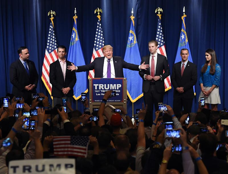 Donald Trump speaks as his sons Donald Trump Jr., second from left, and Eric Trump, third from left, look on during a caucus night watch party in Las Vegas last February. (Photo: Ethan Miller/Getty Images)