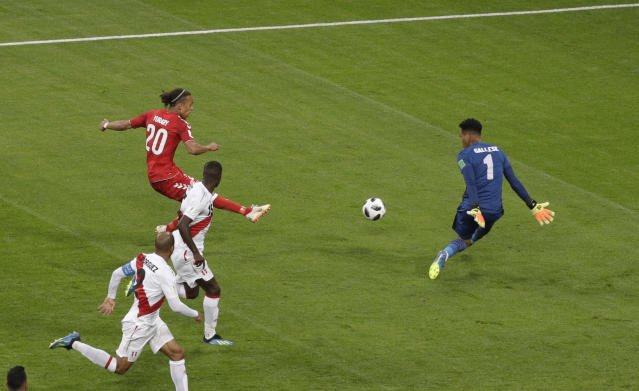 Denmark's Yussuf Yurary Poulsen scores a goal during the group C match between Peru and Denmark at the 2018 soccer World Cup in the Mordovia Arena in Saransk, Russia, Saturday, June 16, 2018. (AP Photo/Gregorio Borgia)