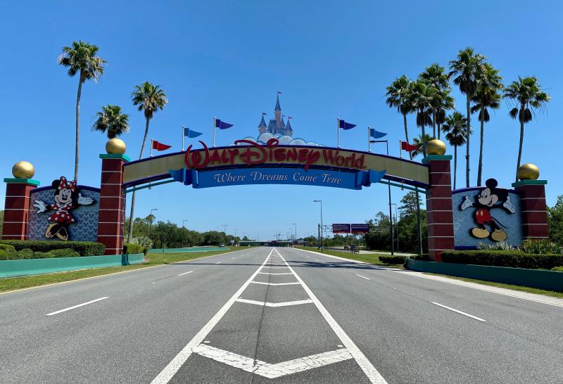 An empty road leads into a deserted Disney resort after it was closed due to the COVID-19 pandemic in Kissimmee, Florida on May 5, 2020. (Photo by Daniel SLIM / AFP) (Photo by DANIEL SLIM/AFP via Getty Images)
