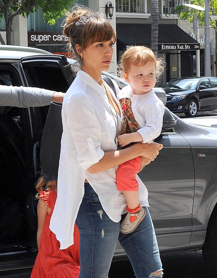 51131173 'Machete Kills' actress Jessica Alba and her family spotted out for lunch at Bouchon in Beverly Hills, California on June 15, 2013. Jessica looked sad while she and Haven sat on the steps outside. FameFlynet, Inc - Beverly Hills, CA, USA -  1 (818) 307-4813