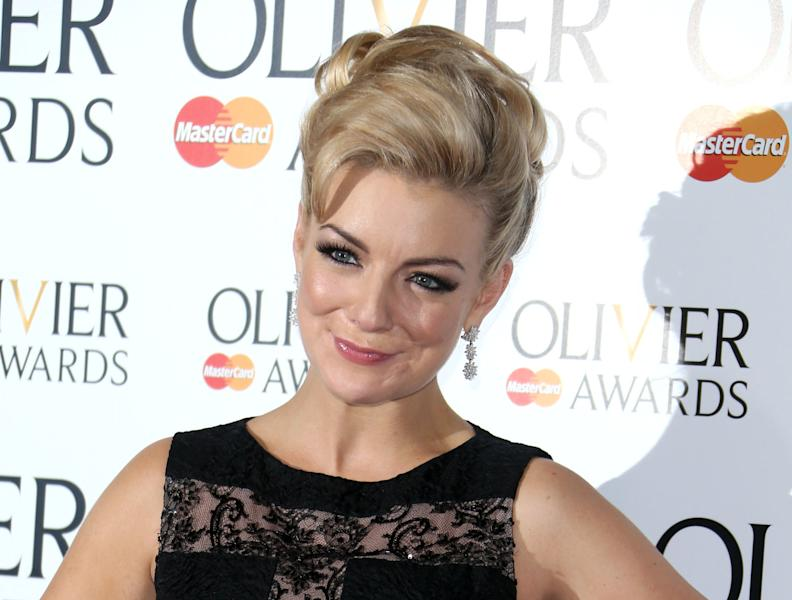 "FILE - In this April 28, 2013 file photo, British actress Sheridan Smith appears at the Olivier Awards 2013 at the Royal opera House in London. Smith, known for her comedic roles on stage and TV, was nominated for an International Emmy award for her role as the title character in the ITV drama series, ""Mrs. Biggs,"" The awards will be presented at a ceremony on Nov. 25 at the Hilton New York Hotel. (Photo by Joel Ryan/Invision/AP, File)"