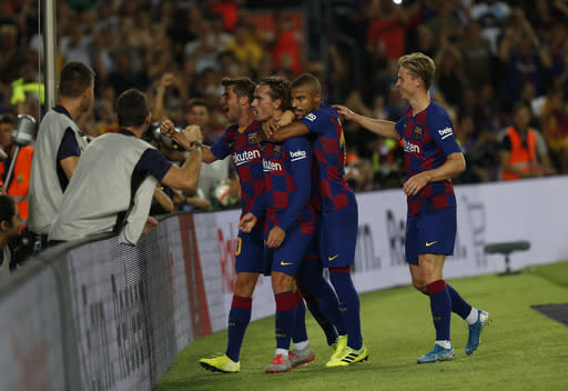 Barcelona's Antoine Griezmann, second left, celebrates after scoring with his teammates his side's second goal during the Spanish La Liga soccer match between FC Barcelona and Betis at the Camp Nou stadium in Barcelona, Spain, Sunday, Aug. 25, 2019. (AP Photo/Joan Monfort)