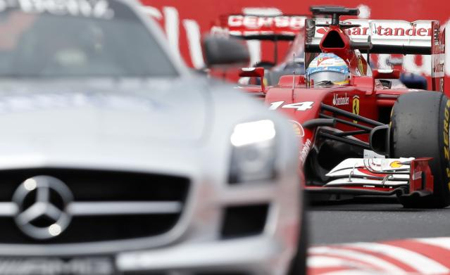 Ferrari driver Fernando Alonso of Spain follows the safety car during the Hungarian Formula One Grand Prix in Budapest, Hungary, Sunday, July 27, 2014. (AP Photo/Darko Vojinovic)